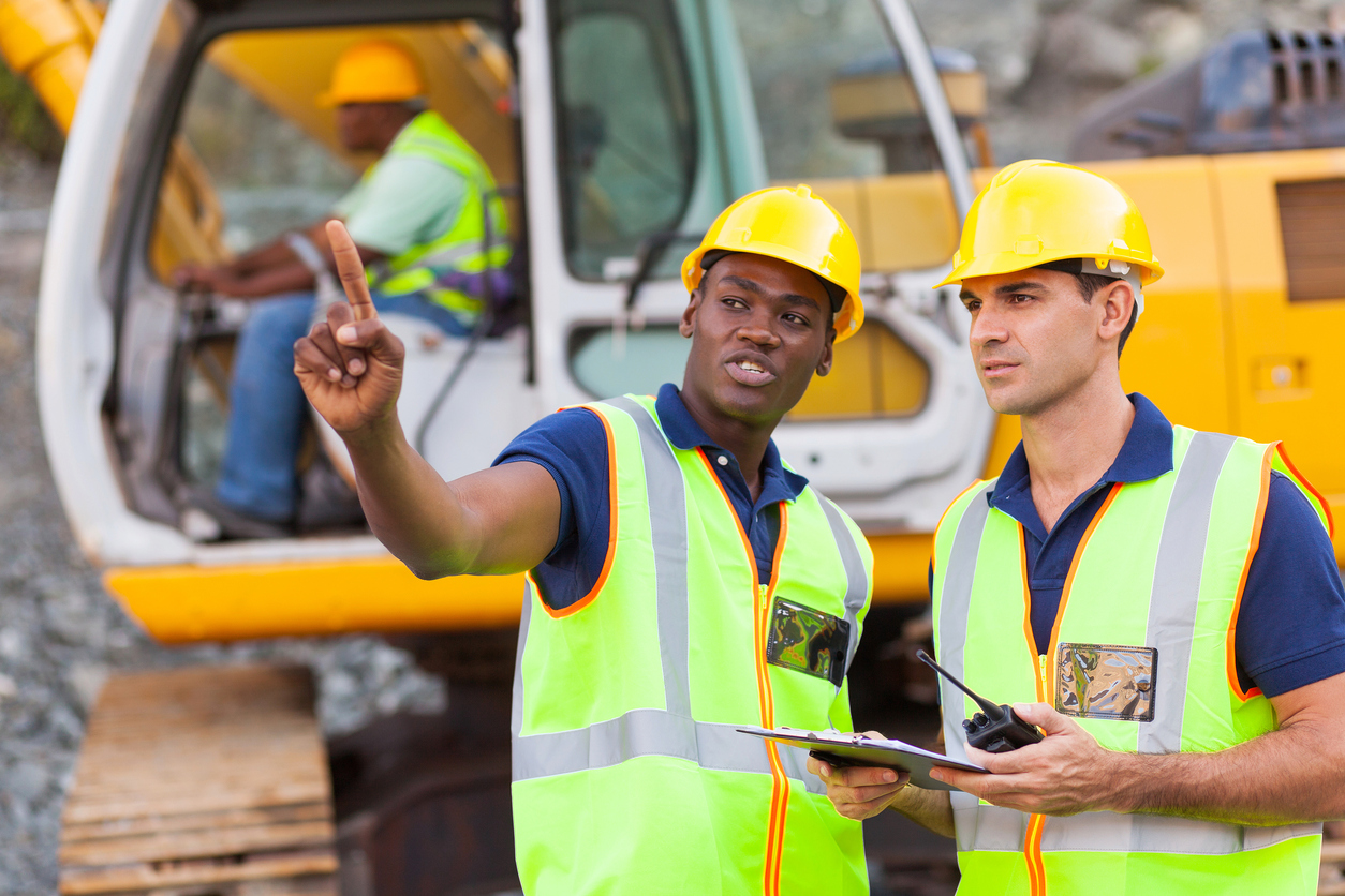 Co-workers talking at construction site